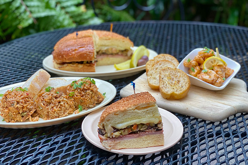 Muffuletta and other food items on table