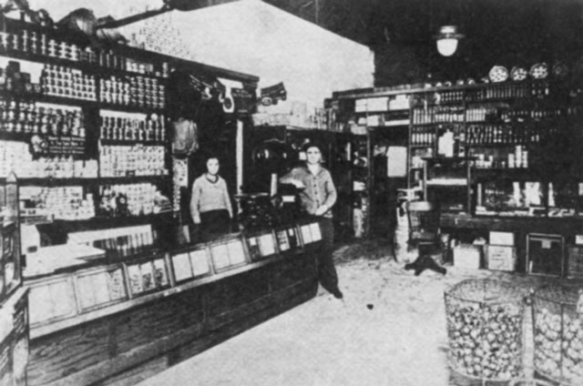 Photo of Labourdette's Grocery with 2 workers inside