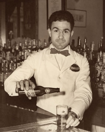 Photo of Napoleon House bartender pouring a drink
